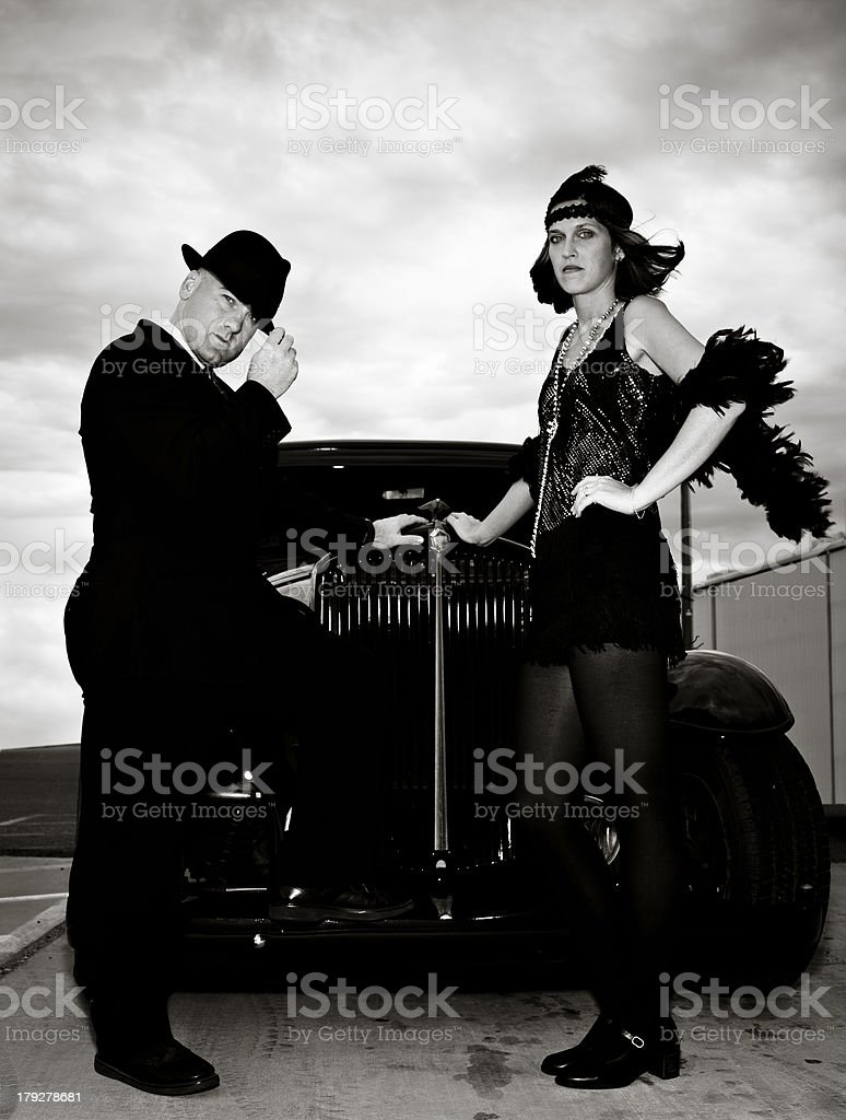 Man and Woman In 1920s Vintage Clothing With Antique Car stock photo