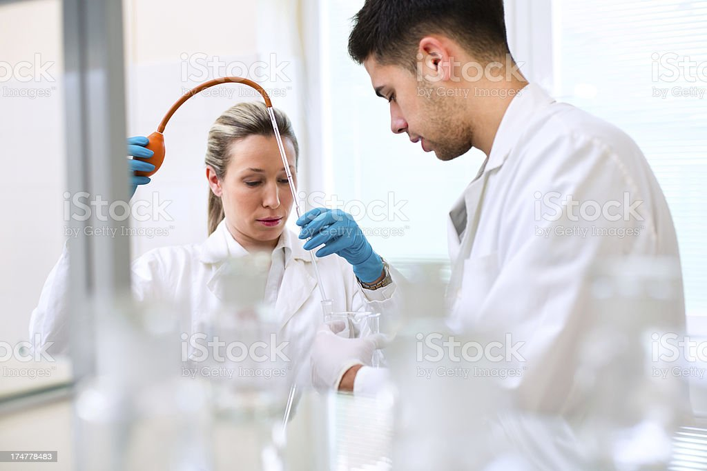 Man and woman in a laboratory royalty-free stock photo