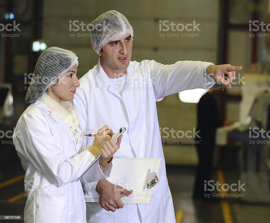Man and woman in food processing plant royalty-free stock photo