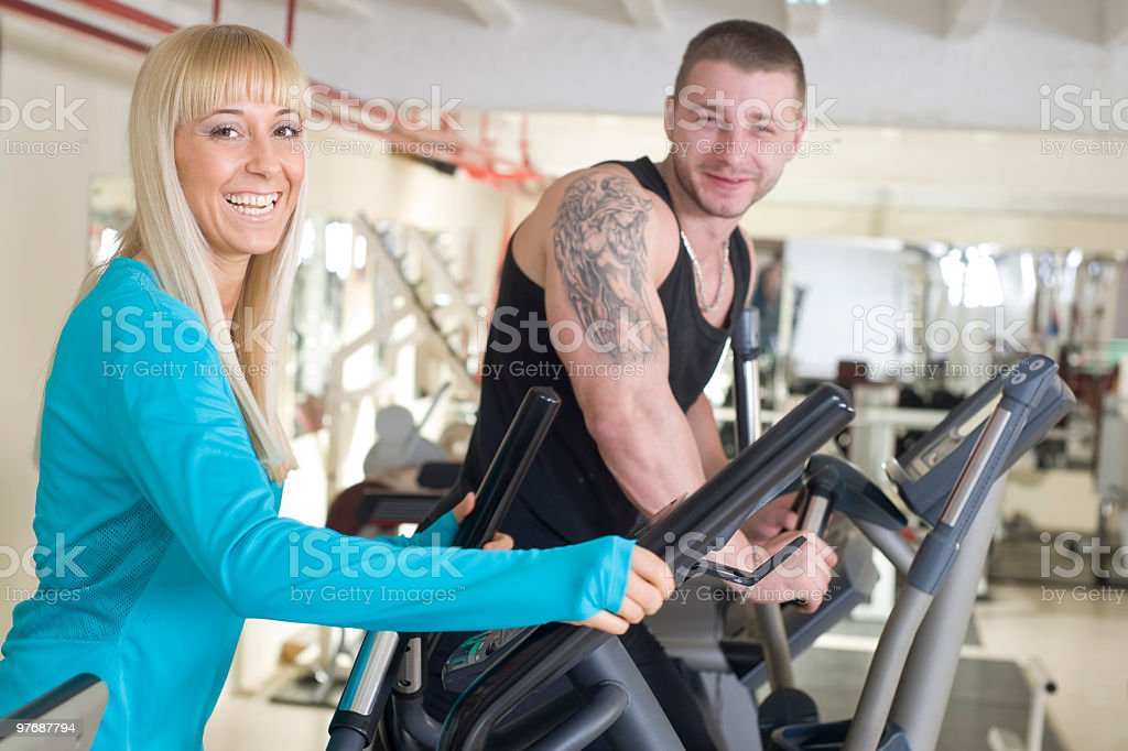 man and woman in health club royalty-free stock photo