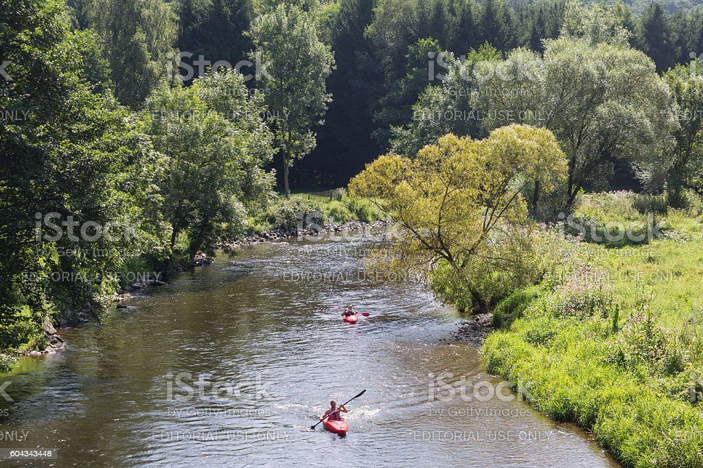 Man and woman in kayak at river Ourthe, Belgium stock photo