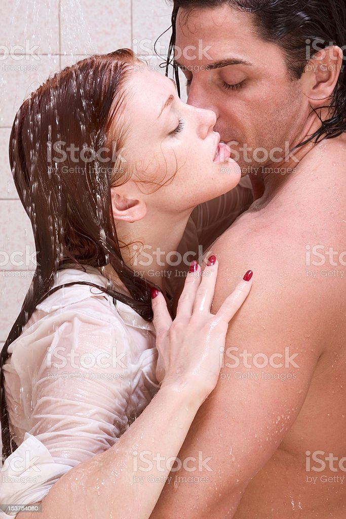 women and men kissing in the shower