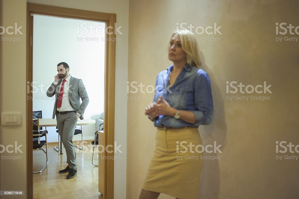 Man and woman in office stock photo