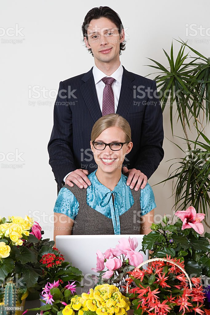 Man and woman in office with plants stock photo