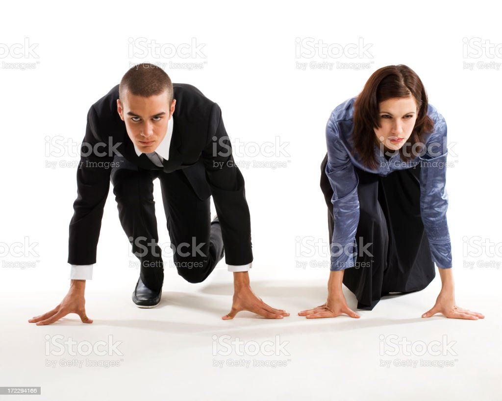 Man and woman in racers ready position on the ground royalty-free stock photo