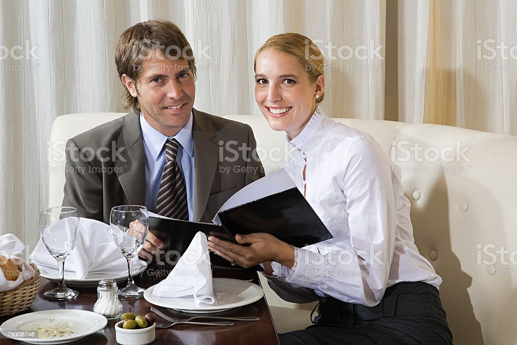 Man and woman in restaurant stock photo