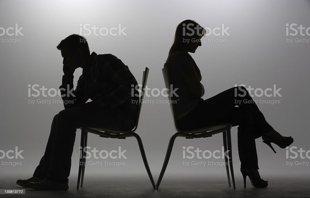 Man and woman in silhouette stock photo