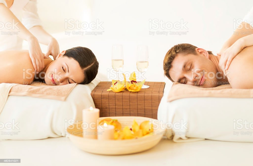 man and woman in spa salon having massage stock photo