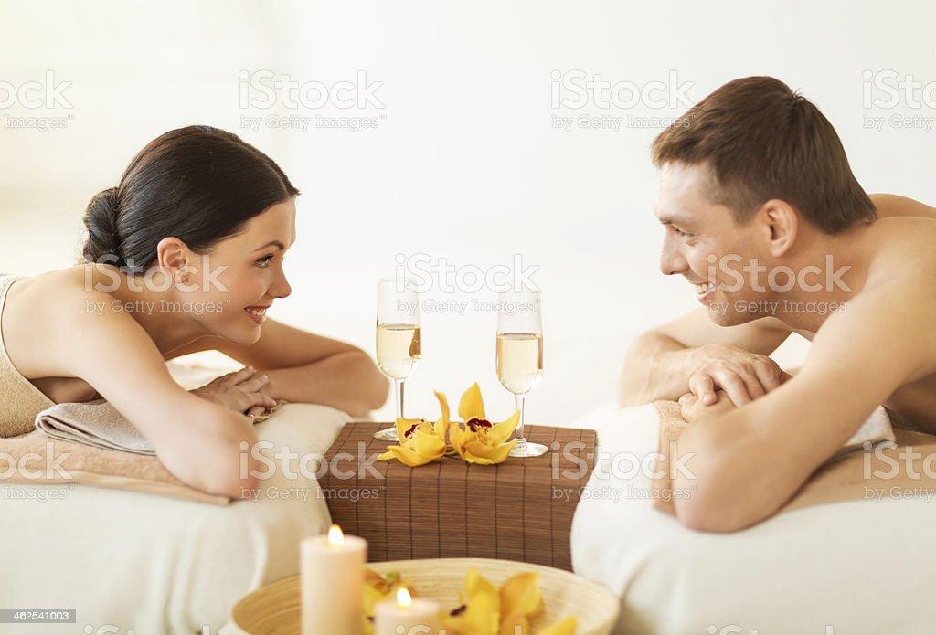 man and woman in spa salon lying on massage desks stock photo
