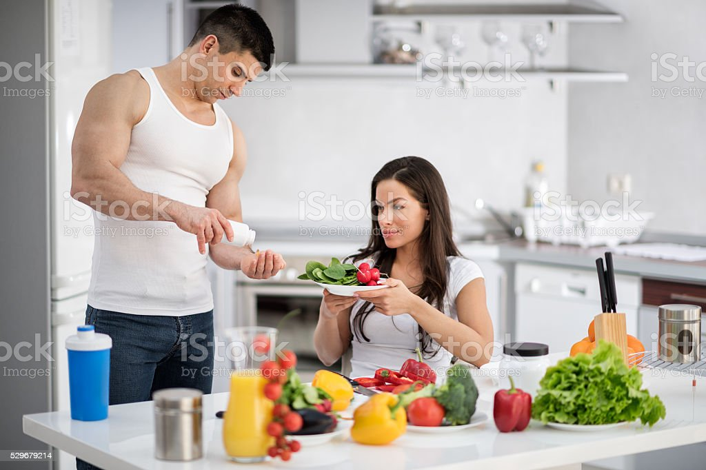 Man and woman in the kitchen stock photo