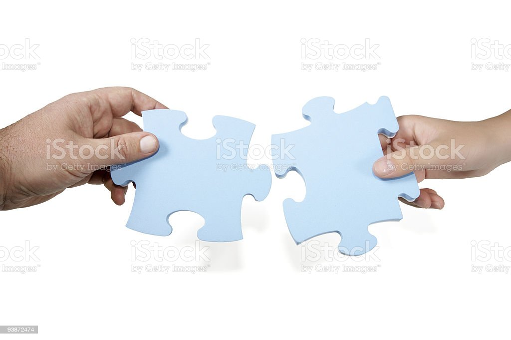 Man and woman joining puzzle stock photo