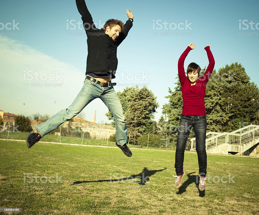 Man and woman jumping  - Student leisure royalty-free stock photo