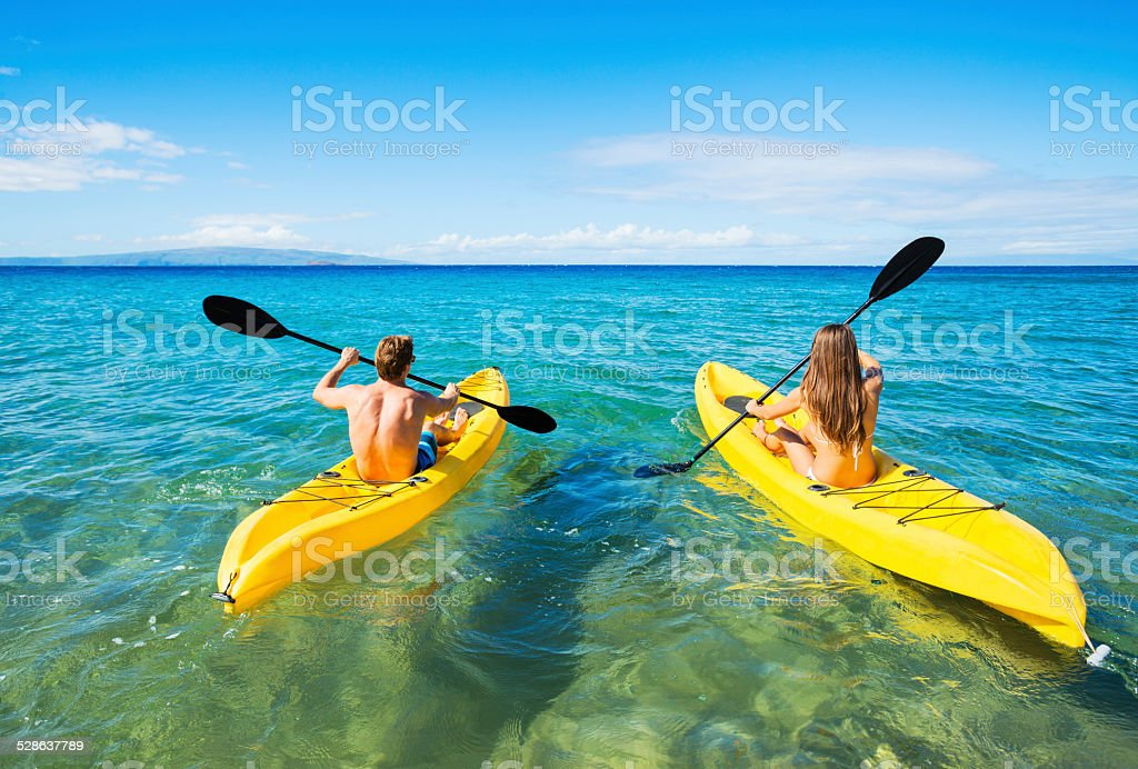 Man and Woman Kayaking in the Ocean stock photo