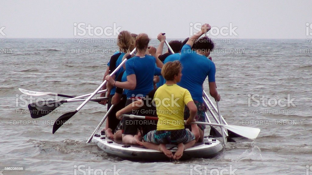 Man And Woman Kneeling On Rubber Boat Canoeing.Kijkduin Beach stock photo