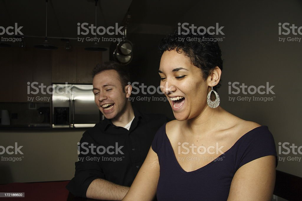 man and woman laughing at a table royalty-free stock photo