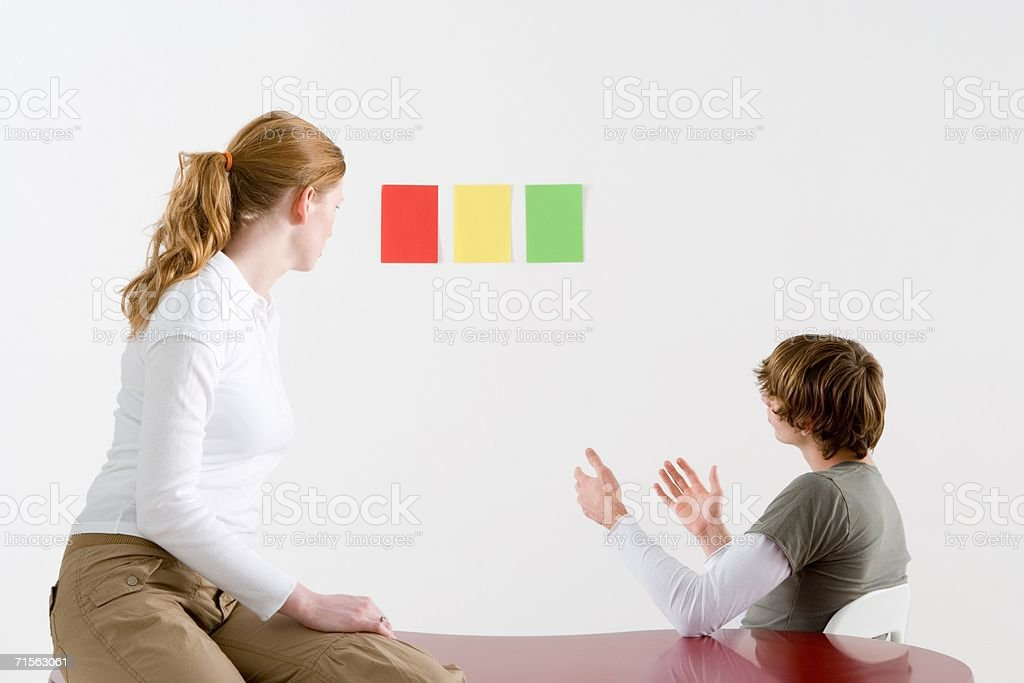 Man and woman looking at colours royalty-free stock photo