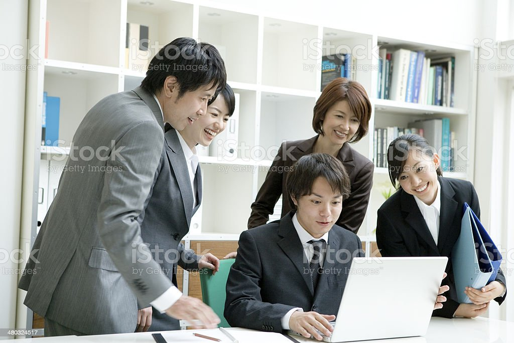 Man and woman looking at PC stock photo
