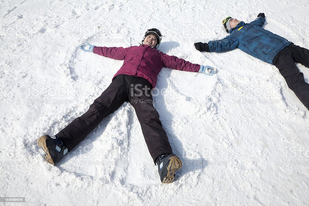 Man and Woman Making Snow Angel stock photo