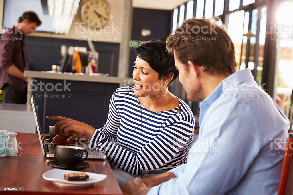 Man and woman meeting over coffee in a restaurant stock photo