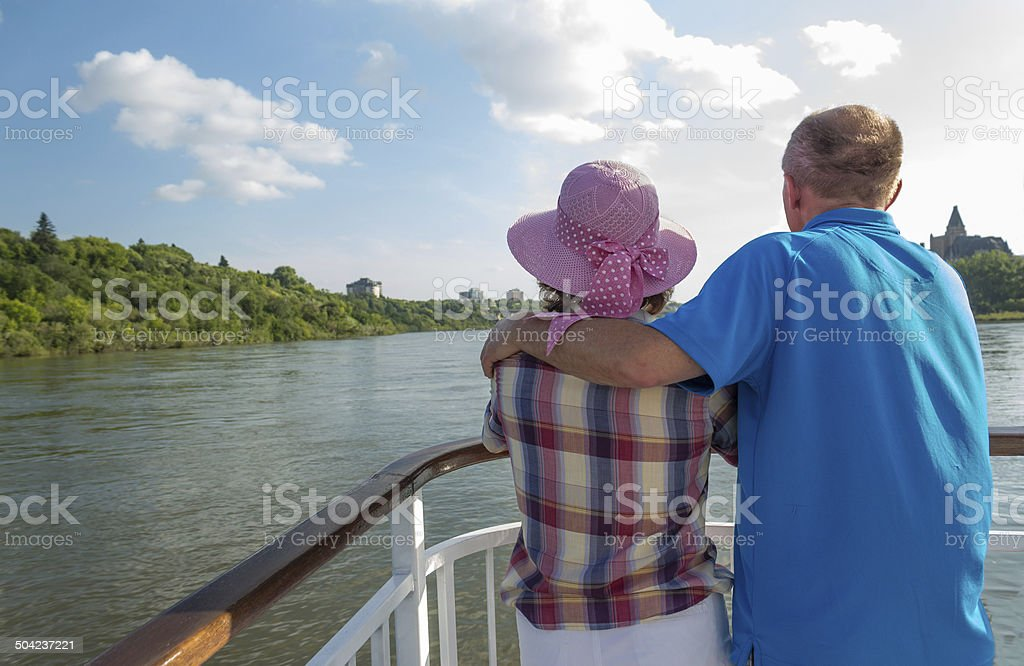 man and woman on a boat stock photo