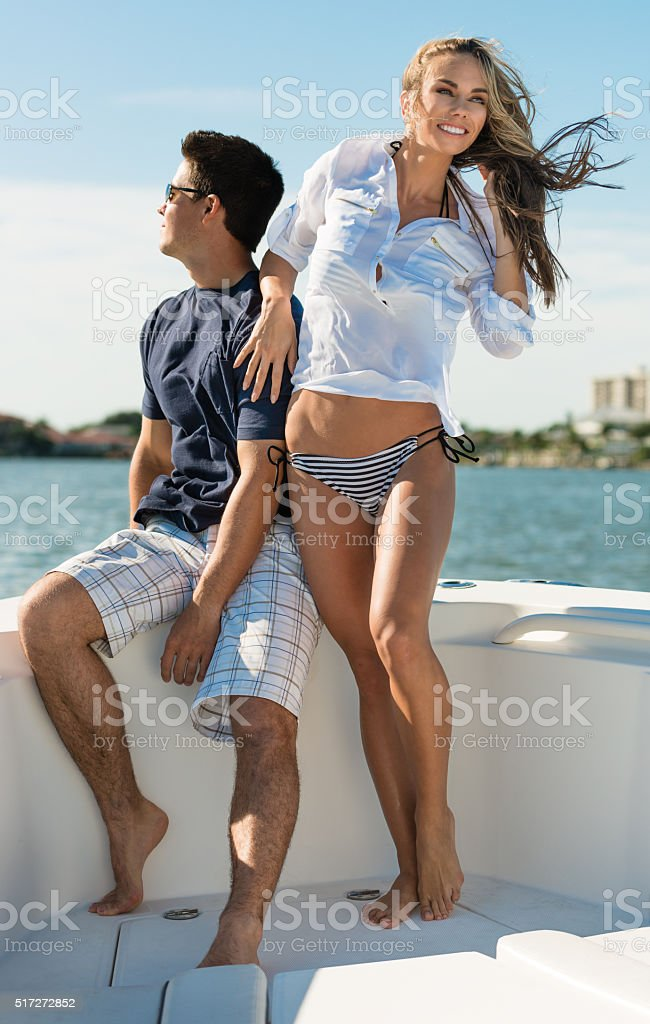 Man and Woman on Boat stock photo
