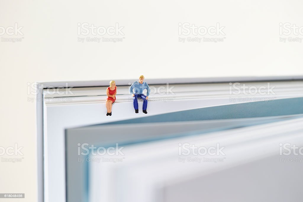 Man and woman on book stock photo