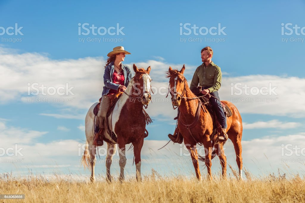 Man And Woman On Horseback stock photo