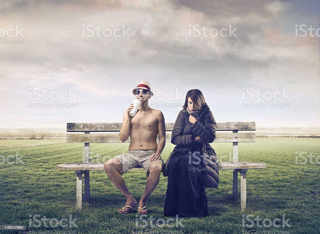 Man and woman on park bench royalty-free stock photo