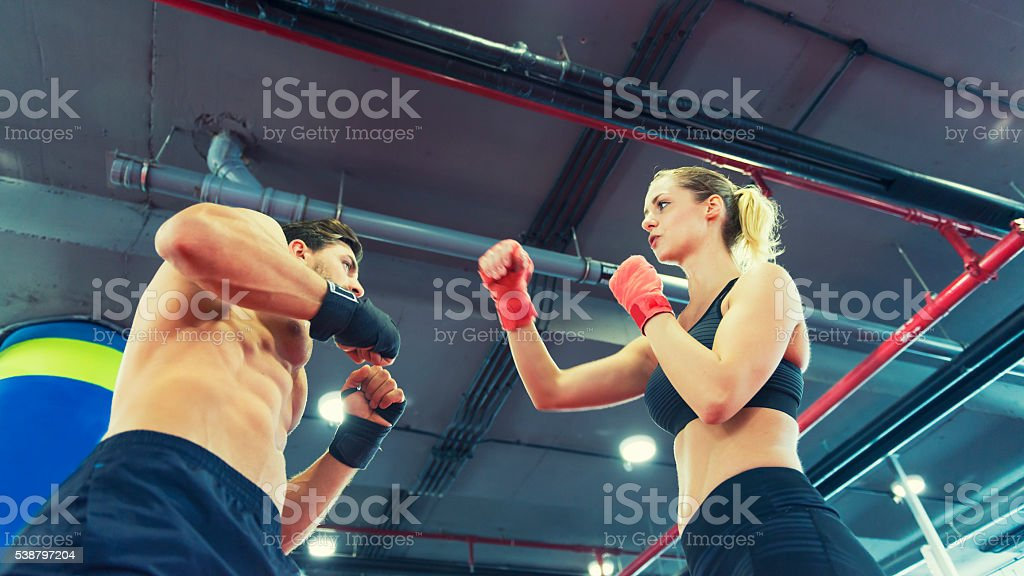 Man and woman on the boxing ring stock photo