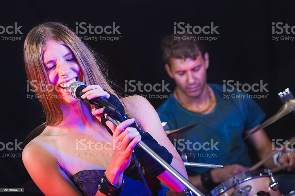 Man and Woman Playing and Singing Rock Music stock photo