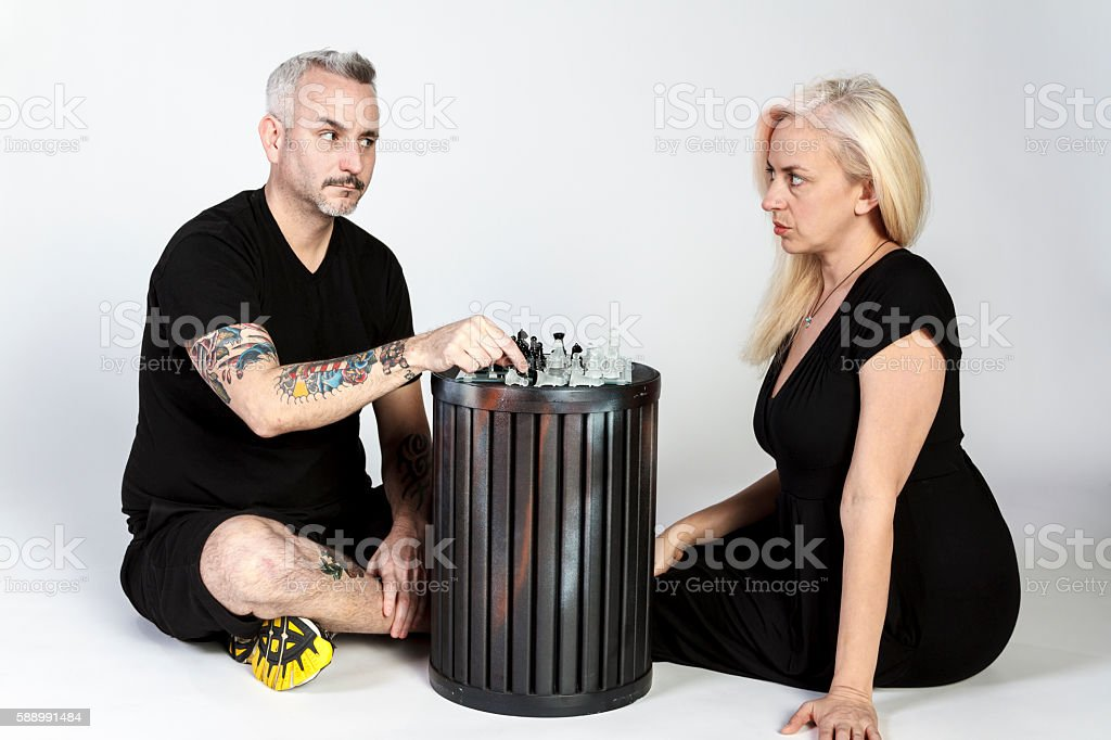 Man and Woman Playing Intense Game of  Chess stock photo