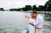 man and woman posing on the lake