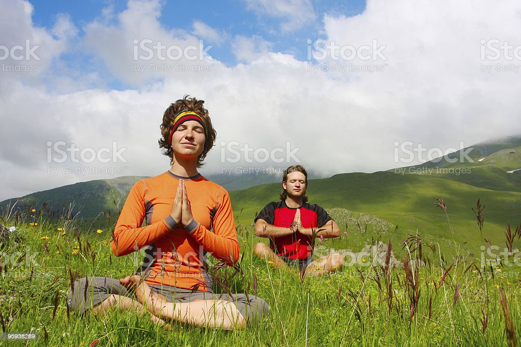 Man and woman practicing yoga stock photo