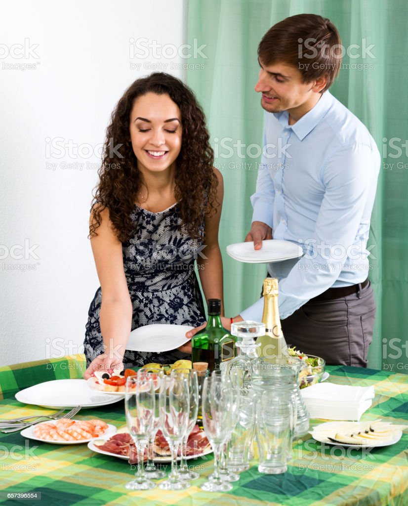 Man and woman preparing on the table stock photo