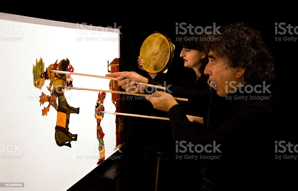 Man and woman putting on puppet show stock photo