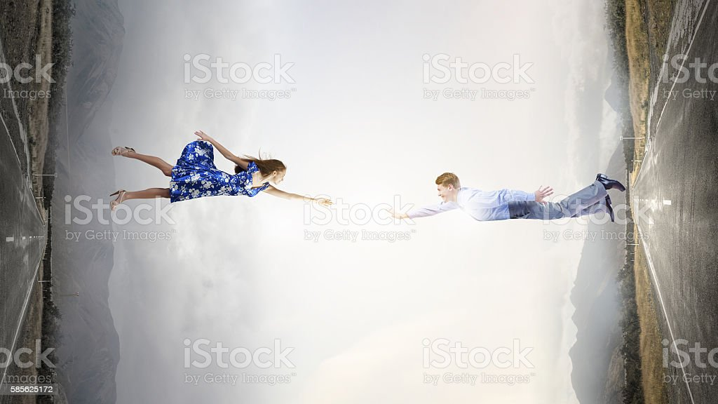 Man and woman reach hands to touch . Mixed media stock photo