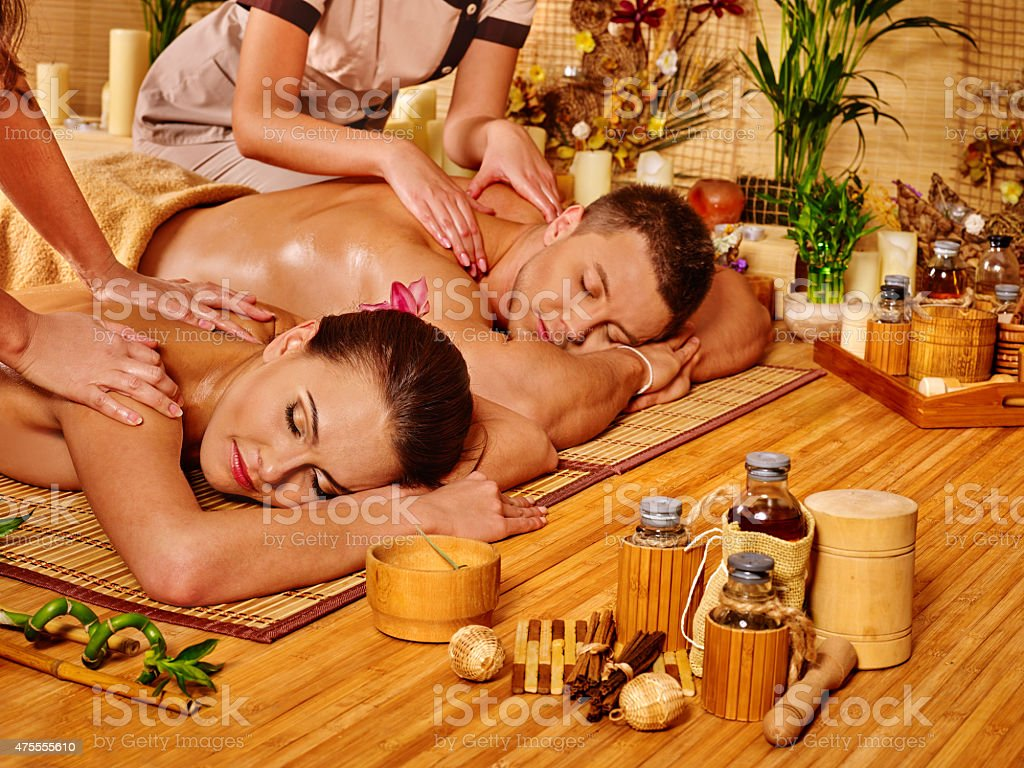 Man and woman relaxing in spa stock photo