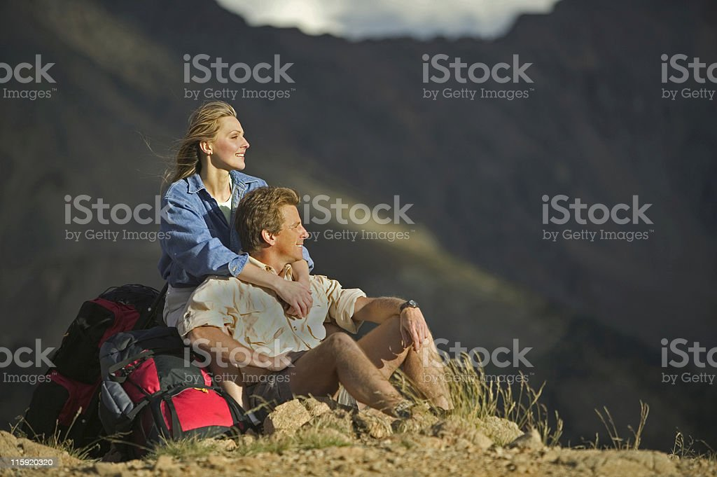 Man and Woman Relaxing with Backpacks royalty-free stock photo