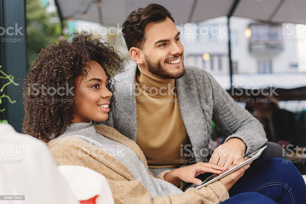 man and woman resting at home stock photo