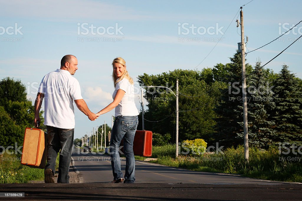 Man and woman running on the road royalty-free stock photo