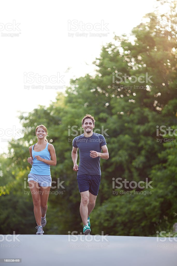 Man and woman running together royalty-free stock photo