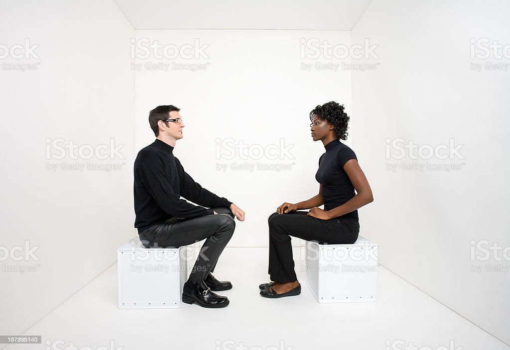 Man and woman sitting across from each other royalty-free stock photo
