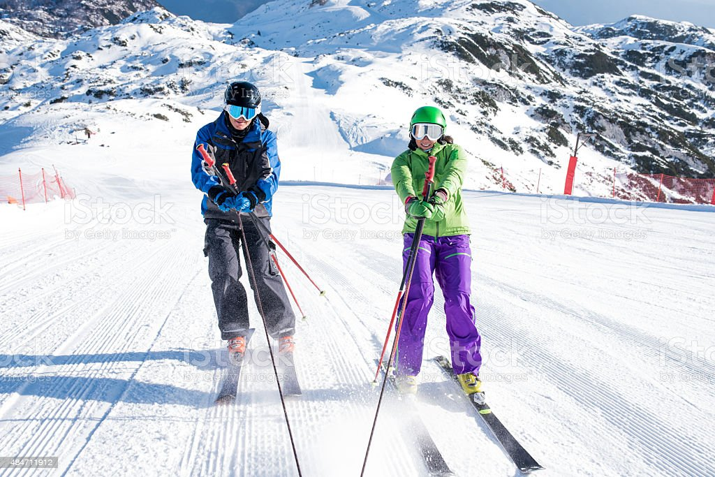 Man and woman skiing stock photo