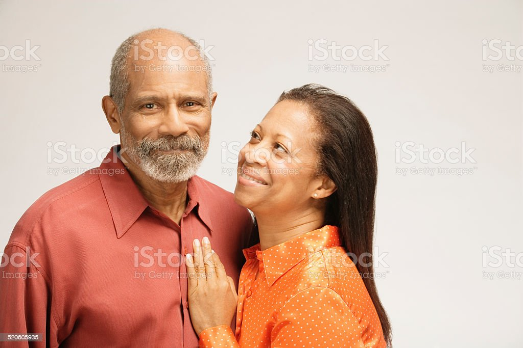 Man and woman smiling, close-up stock photo