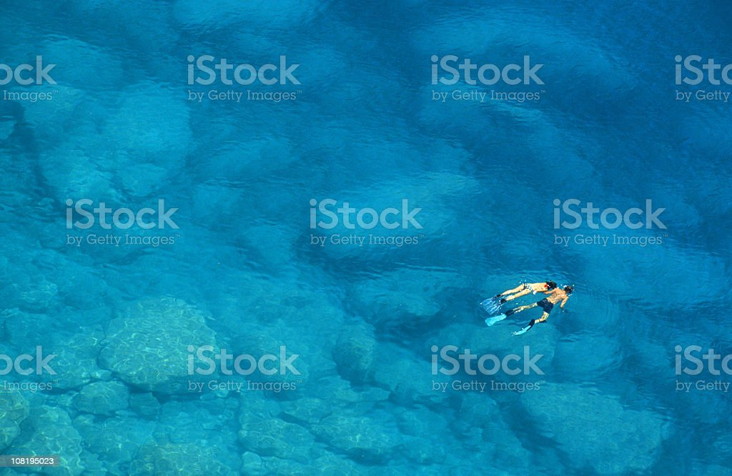 Man and Woman Snorkelling in Blue Mediterranean Sea stock photo