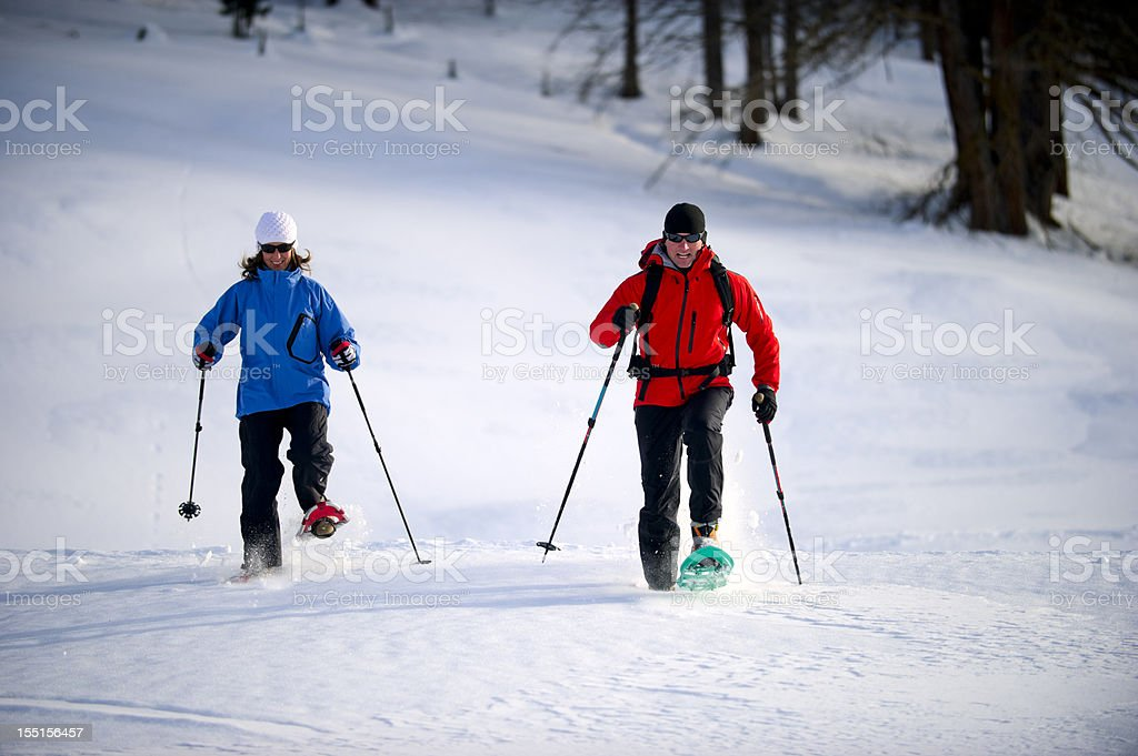 Man and  Woman Snowshoeing royalty-free stock photo