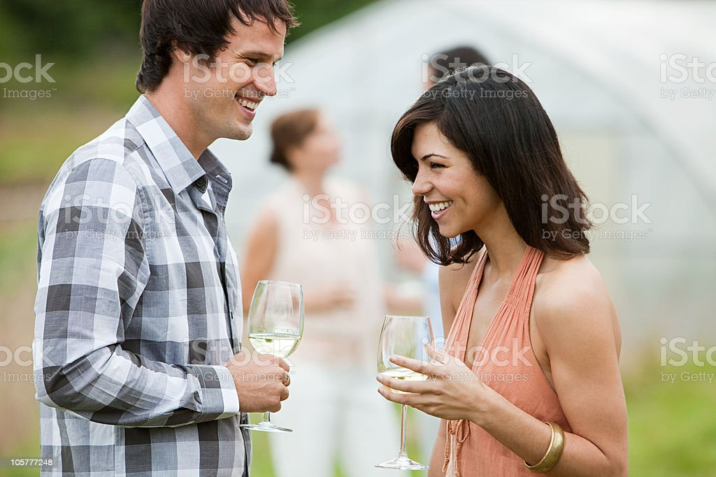 Man and woman socializing outdoors stock photo