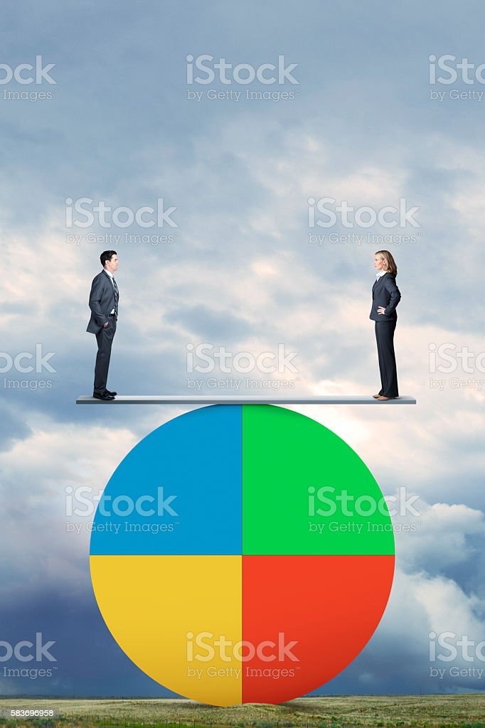 Man And Woman Stand On Seesaw On Pie Chart stock photo