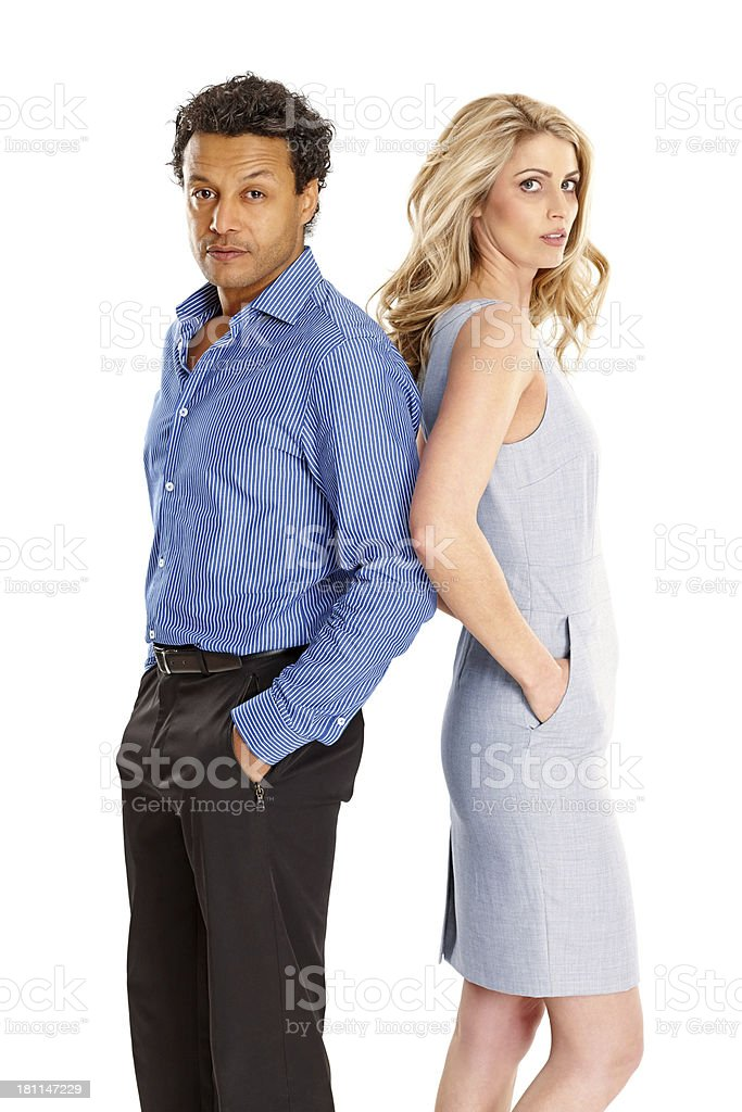 Man and woman standing against each other royalty-free stock photo