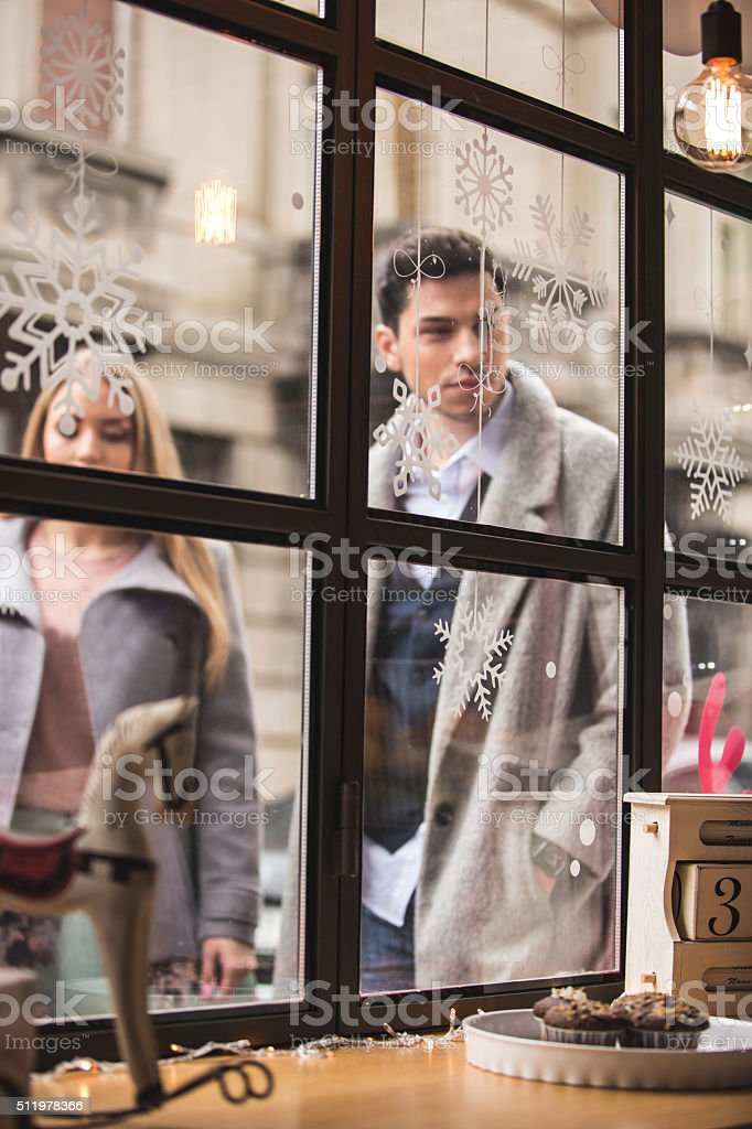 Man and woman standing outside cake shop stock photo